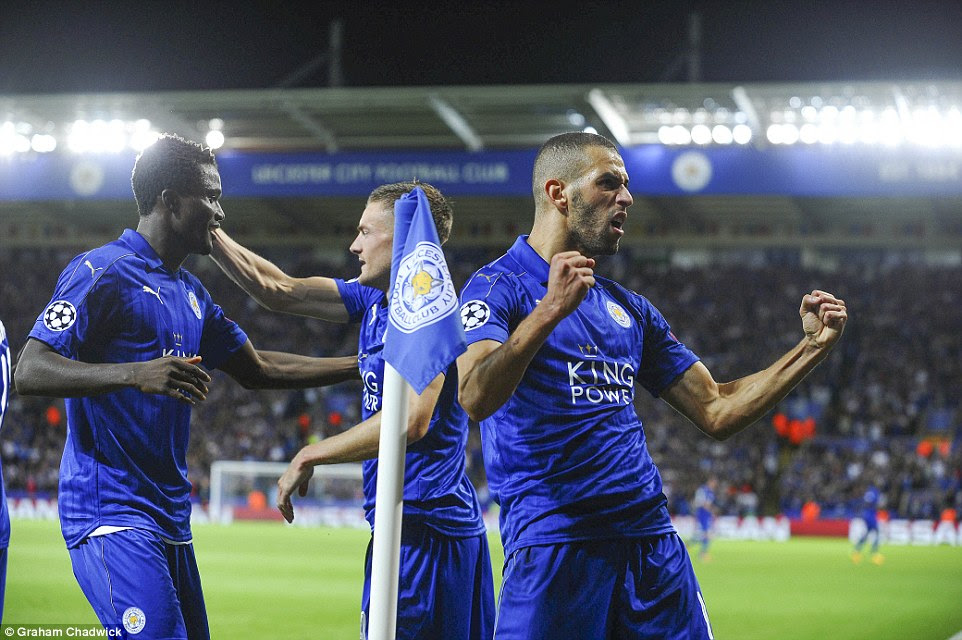 Slimani pumps his fists as Leicester snatch a first-half lead against their Group G clash at the King Power Stadium