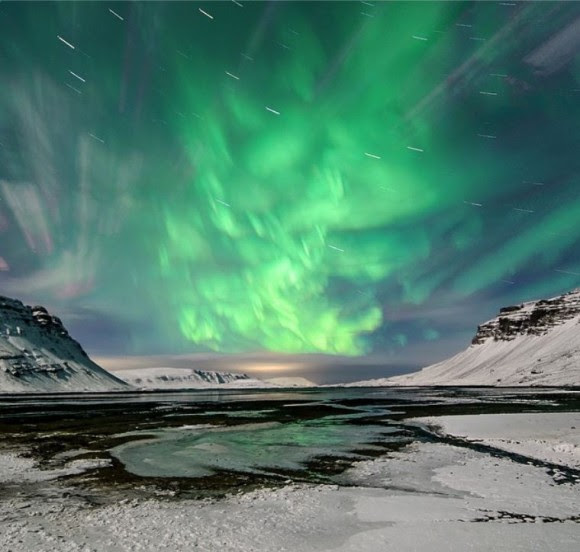 Aurora dancing in the Hvalfjörður fjord in Iceland. Credit and copyright: Ólafur Haraldsson.