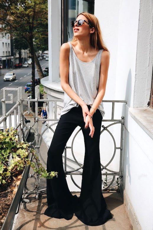 Le Fashion Blog Blogger Style Sunglasses Oversized Grey Tank Top Flared Jeans Via Maja Wyh
