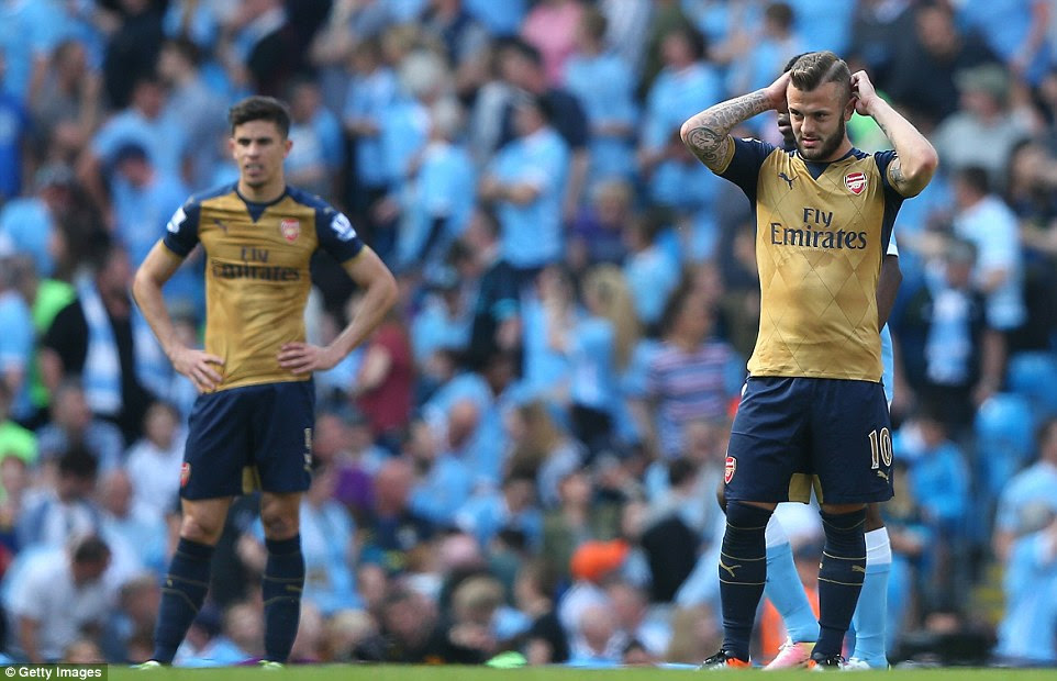 Midfielder Jack Wilshere (right) cuts a dejected figure as Arsenal concede a second goal in the clash with their Premier League rivals
