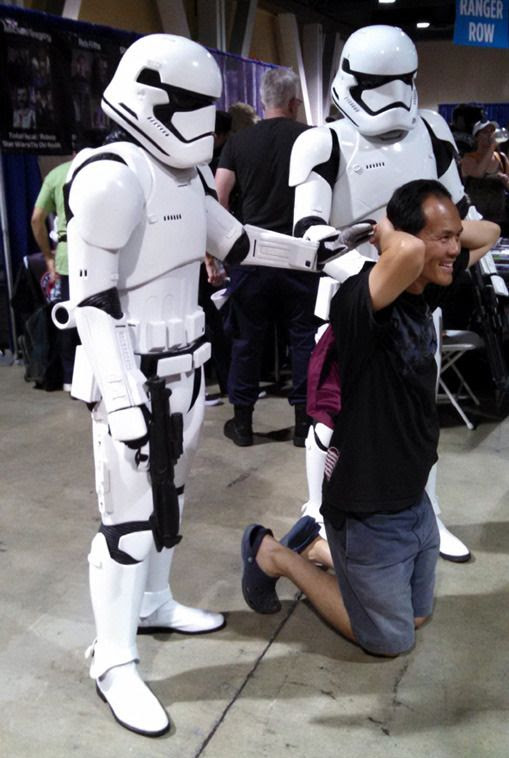 If it's anything like the spoilers I read for STAR WARS: THE FORCE AWAKENS, this dude will be taken by the Stormtroopers to Kylo Ren for interrogation...at Long Beach Comic Con on September 12, 2015.