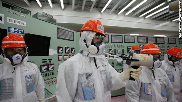 Staff measure radiation levels in the reactors' central control room at the crippled Fukushima Daiichi power plant in March.