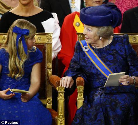 Dutch Princess Beatrix, right, speaks with Princess Catharina-Amalia
