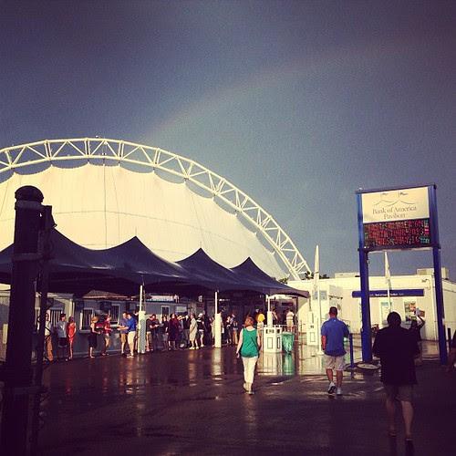 Pre-concert rain shower and rainbow.