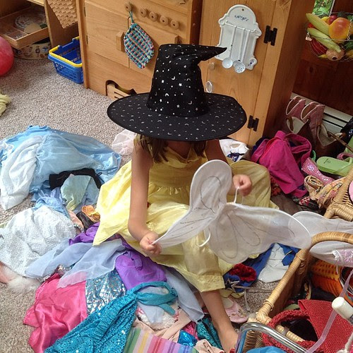Rediscovering and diving into her dress up corner