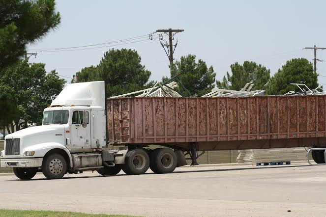 Do you remember this Marlon Brock photo, previously published on The Common Sense Show. This is from the Midland, TX. Walmart where they are hauling away the old to make way for the new.  Who are they making room for?