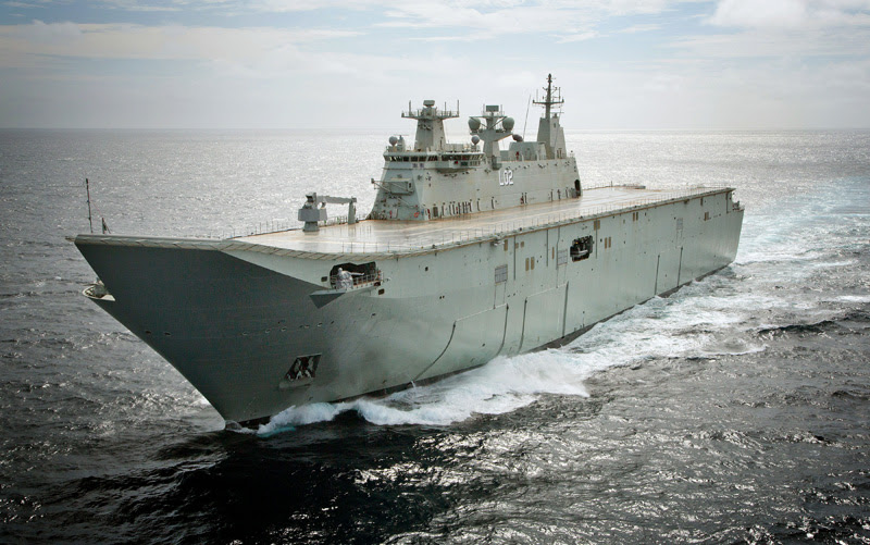 The largest ship ever built for the Royal Australian Navy, Landing Helicopter Dock NUSHIP Canberra, passes through Sydney Heads for the first time. Photo: RAN by Tom Gibson