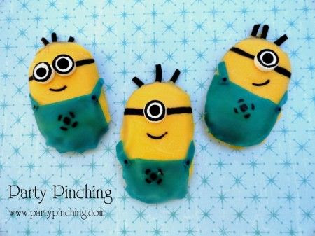 """Love the movie """"Despicable Me"""" and loved the little Minions.  I made these Minions out of Milano cookies!  I used yellow candy melts, blue fruit rollups, white Smarties candies, black licorice rope and edible black marker."""