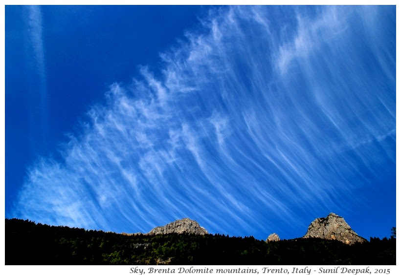 Airplane fumes in the sky, Trento, Italy - Images by Sunil Deepak