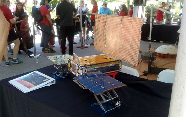 A full-size replica of NASA's Red Planet-bound Mars Cube One spacecraft...on display at Explore JPL on June 9, 2018.