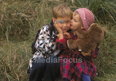 Stock Photo Small Girl Holding Teddy Bear Kissing Image 12008