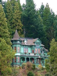 A fabulously amazing dose of turquoise tucked amongst the towering trees. #Victorian #house #home #vintage #turquoise
