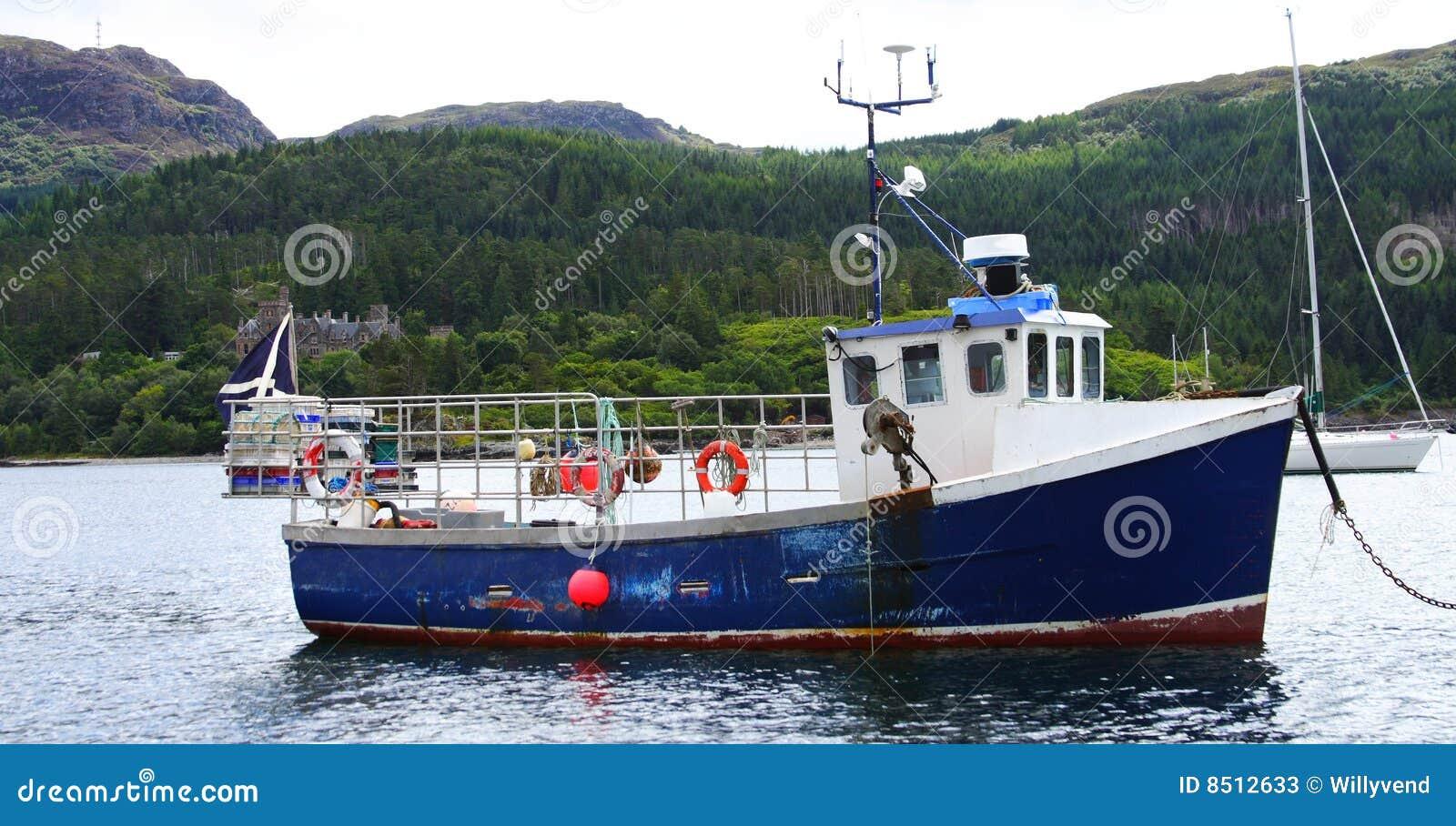 Old fishing boat in the bay of plockton upon loch carron, Scotland.