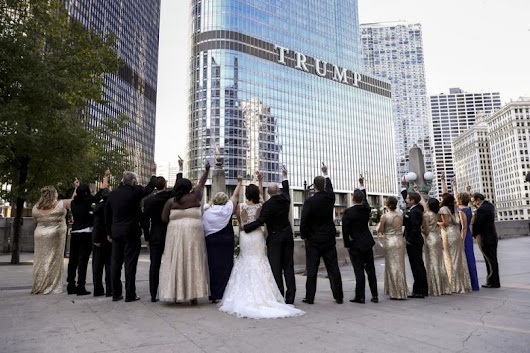 LOOK: Newlyweds, Wedding Party Give Middle Finger to Trump Building