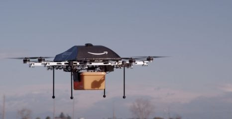 Amazon completes first drone delivery, reveals plans for flying drone hub