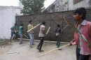 Garment workers try to break gate of factory during protest to demand capital punishment for those responsible for collapse of Rana Plaza building in Savar