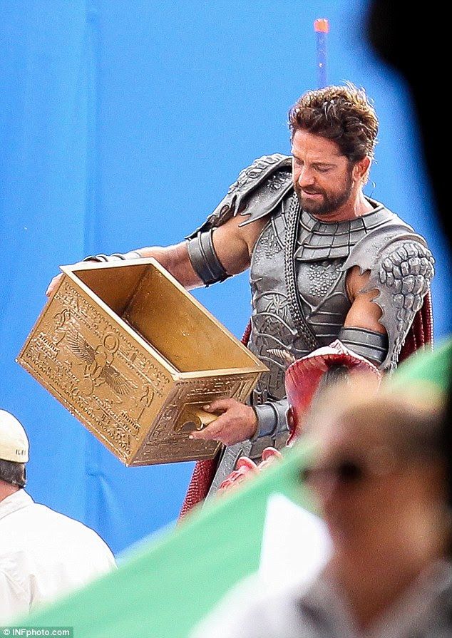 Boxed in: The scene called for Gerard to juggle a gold-plated prop box, but moviegoers won't find out the meaning until the film's release in 2016