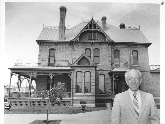John Driggs standing in front of the Rosson House in