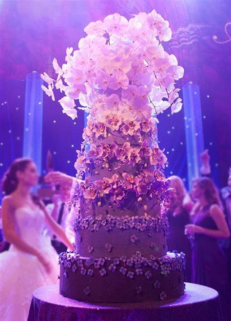 This 6 tier ombre purple wedding cake features hand made