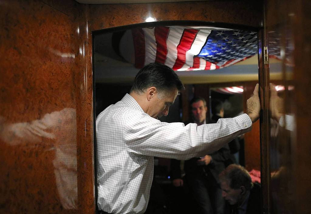 Republican presidential candidate, former Massachusetts Gov. Mitt Romney listens in on conference call with advisers aboard his campaign bus en route to a campaign rally at Avon Lake High School in Avon Lake, Ohio. Romney has canceled other campaign events on October 29 and 30 due to Hurricane Sandy.