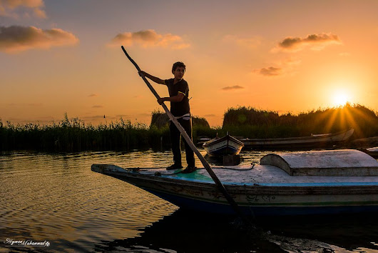 fisher boy with the sun by AymanMuhammad on YouPic