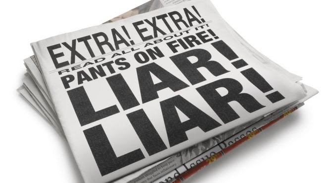 Newspaper with 'Liar Liar' headline