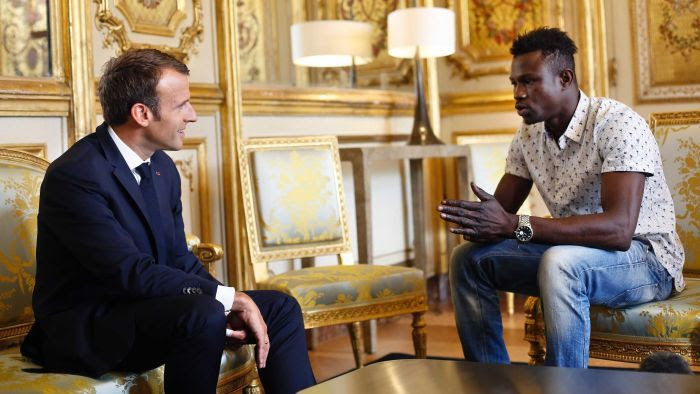 """Mr Gassama told Mr Macron he was """"trembling"""" after saving the child. (Photo: AP: Thibault Camus)"""