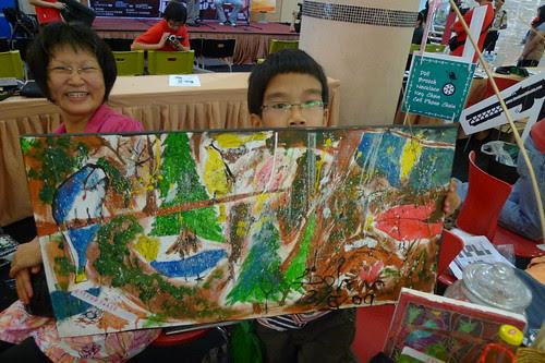 Kid shows his artwork