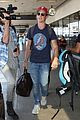 miles teller and keleigh sperry wear matching hats after miami vacation 03
