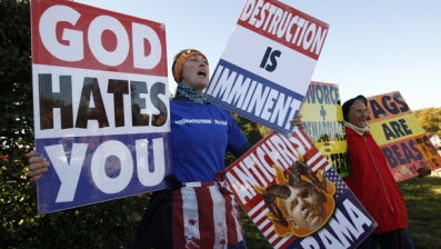 Reuters. Nov. 11, 2010: Members of the Westboro Baptist Church hold anti-gay signs at Arlington National Cemetery in Virginia on Veterans Day.