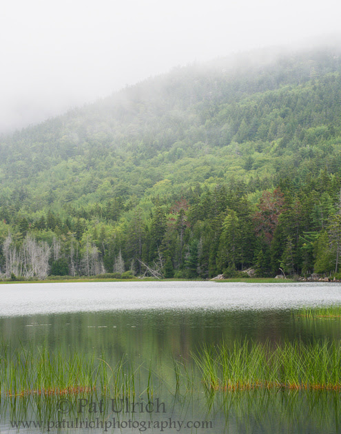 Photograph of the fog rolling over Upper Hadlock Pond in Acadia National Park
