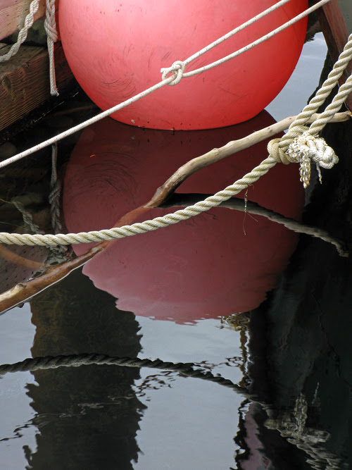 rope and other harbor reflections at Kasaan, Alaska