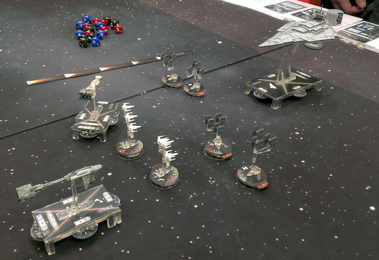 http://www.awkwardgeeks.com/wp-content/uploads/star-wars-armada-gameplay.jpg
