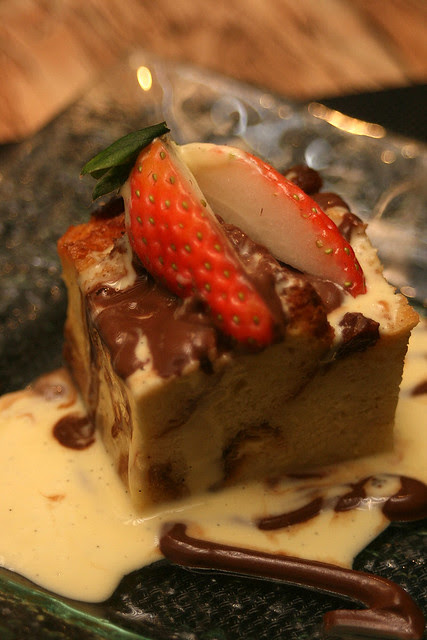 Home-made Bread Pudding with vanilla and chocolate sauce