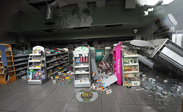 Chile Earthquake: The walls and aisles of a pharmacy in Vina del Mar are seen destroyed