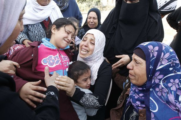 http://i3.mirror.co.uk/incoming/article1440317.ece/ALTERNATES/s615/Palestinian+women+and+children+cry+during+the+funeral+of+Audi+Naser