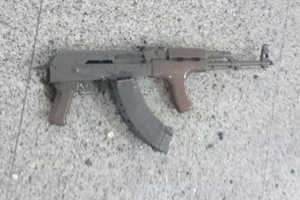 A weapon is seen on the floor at Ataturk airport