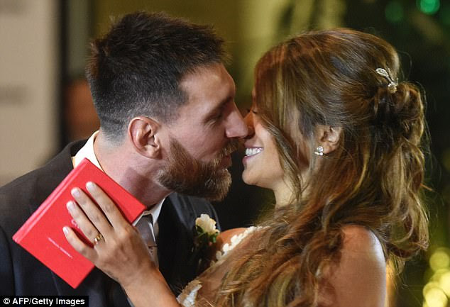 Messi and his new bride lock lips as they celebrate tying the knot at the Rosario ceremony