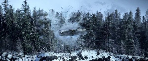 The Millennium Falcon flies through a thicket of trees after coming out of hyperspace above Starkiller Base in STAR WARS: THE FORCE AWAKENS.