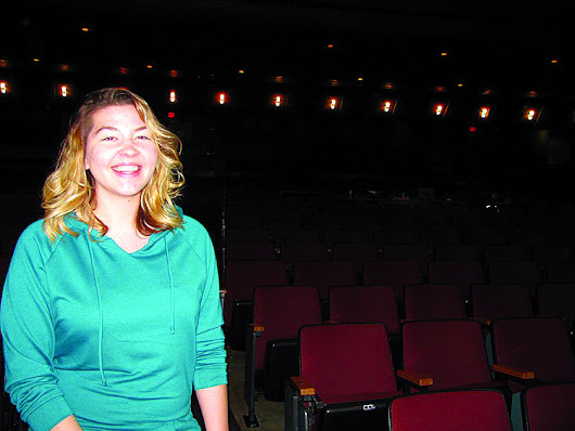 Schools' theater manager at home behind the curtain