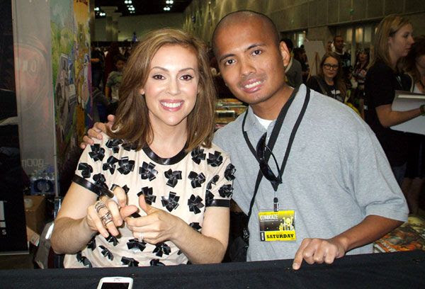 Posing with Alyssa Milano at Stan Lee's Comikaze Expo in downtown Los Angeles, on November 2, 2013.