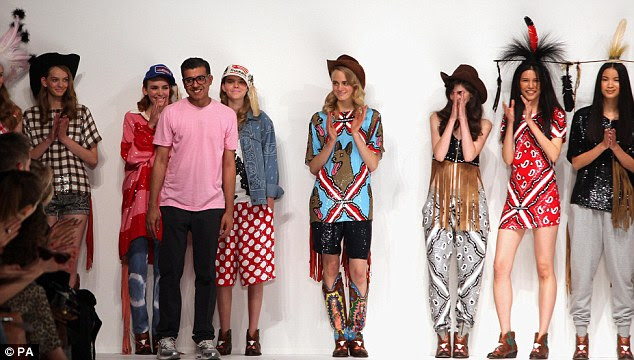 Here he comes: Models on the catwalk with designer Ashish Gupta at the Ashish Spring/Summer collection at Somerset House