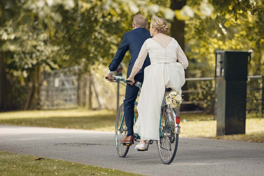 Bride and Groom on Tandem at wedding at Madingley Hall - www.helloromance.co.uk