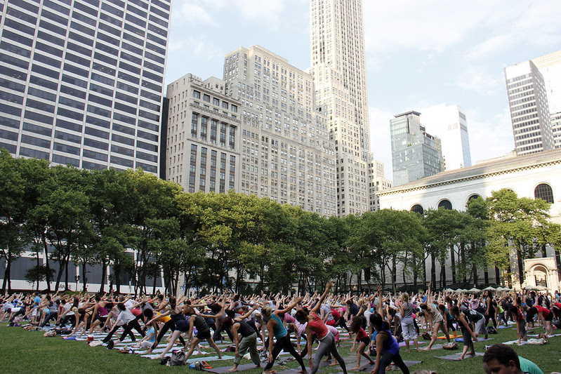 Picture Of People Taken A Free Yoga Class In Bryant Park In New York City. Yoga Classes Are Taught Twice A Week By A Variety Of Talented Instructors.  Thursday Evening Yoga Sessions Are On The Lawn. Photo taken Thursday June 28, 2012