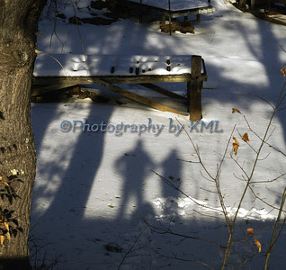 two shadows cast on the surface of the snow covered lake