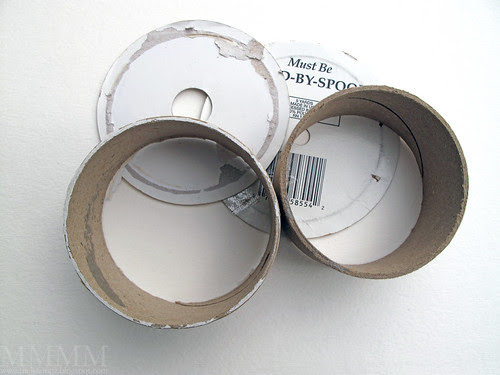 Step 1a) Find two old ribbon spools and remove their labels leaving just the cardboard rings -or left over spools from packing tapes would work nicely