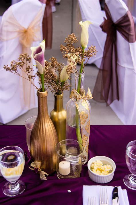Plum, gold bronze wedding colors. Credit: Megan Élan