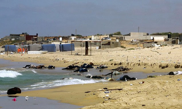Bodies of African would-be migrants are washed up on the shore of al-Qarboli, 30 miles east of Tripoli, Libya