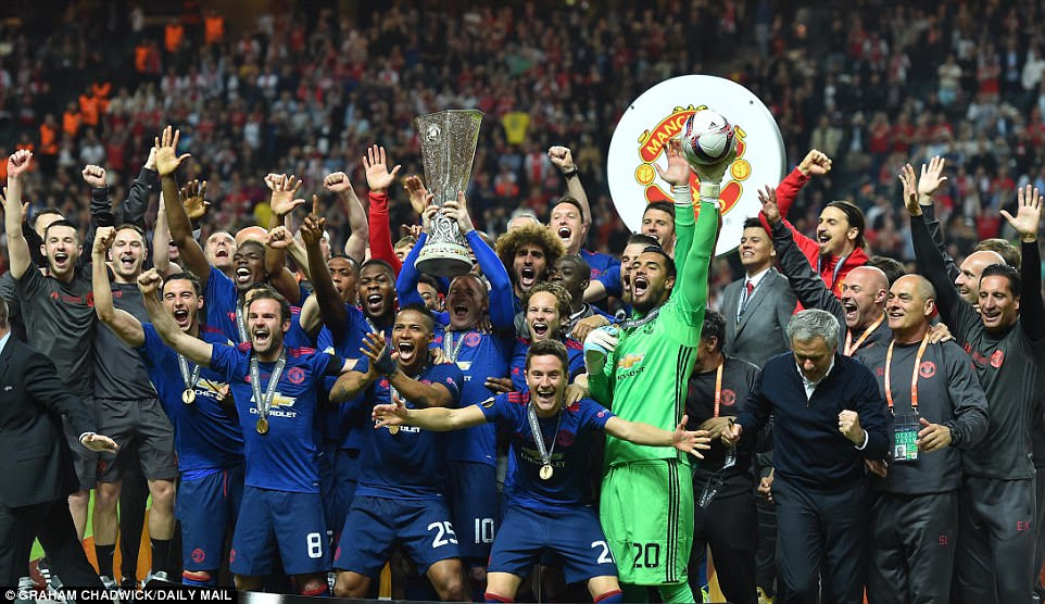 The delighted Manchester United players celebrate with the Europa League trophy after beating Ajax in the final