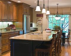 Hardwood floor color matching kitchen cabinets.